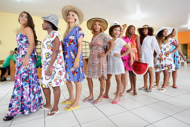 RIO DE JANEIRO, BRAZIL - NOVEMBER 24:  Inmate contestants pose at the annual beauty pageant at the Talavera Bruce womenÕs prison on November 24, 2015 in Rio de Janeiro, Brazil. The pageant aims to humanize and boost the self-esteem of female inmates who receive makeup and hair styling from volunteers. According to the Ministry of Justice, the number of imprisoned females in the country rose 567 percent from 2000 to 2014. Overall, BrazilÕs overcrowded prison population is now the worldÕs fourth largest, with more than 600,000 inmates being held in facilities designed for 377,000, according to Human Rights Watch.  (Photo by Mario Tama/Getty Images)