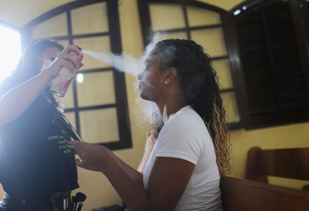 RIO DE JANEIRO, BRAZIL - NOVEMBER 24:  An inmate contestant has her makeup done at the annual beauty pageant at the Talavera Bruce women's prison on November 24, 2015 in Rio de Janeiro, Brazil. The pageant aims to humanize and boost the self-esteem of female inmates who receive makeup and hair styling from volunteers. According to the Ministry of Justice, the number of imprisoned females in the country rose 567 percent from 2000 to 2014. Overall, Brazil's overcrowded prison population is now the world's fourth largest, with more than 600,000 inmates being held in facilities designed for 377,000, according to Human Rights Watch.  (Photo by Mario Tama/Getty Images)