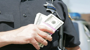 Trappin' With A Badge: Over 50 Corrupt Cops Taken Down Yesterday