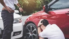 Two drivers man arguing after a car traffic accident collision,